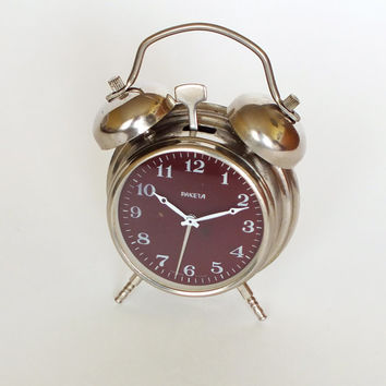 Vintage small mechanical alarm clock Raketa metal case, wrist watch mechanism, Soviet Russian twin bell alarm clock 70s Very silent ticking