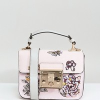 River Island Embroidered Lock Front Mini Satchel Bag at asos.com