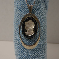 "Cameo on black stone   Silver tone 12"" chain"
