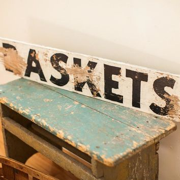 Weathered Wooden Baskets Sign