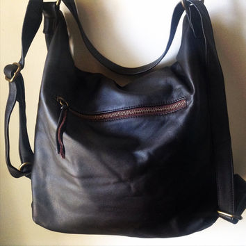Leather convertible bag.Shoulder tote made from lambskin.Handmade soft,perfect for a laptop or travel bag.Leather backpack,fully lined.
