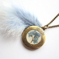 Baby Blue Forget-Me-Not Flowers Preserved under glass like Resin on a Vintage Bronze Locket with matching Marabou Feathers