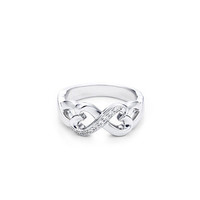 Tiffany & Co. -  Paloma Picasso® Double Loving Heart ring diamonds in 18k gold.