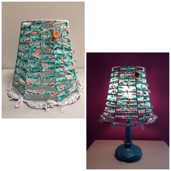 Whimsical bohemian style fabric and lace lamp shade/canopy. Adorned with crocheted metal and beaded flower.