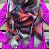 Our 'Lookin' For Love '' Heavyweight scarf is tan in color tan and black plaid with fringe. 100% Acrylic. Approximately 53'' x 58''.