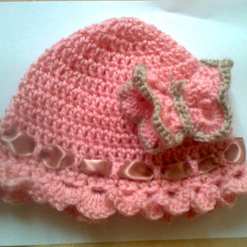 Crocheted baby girl hat with crocheted butterfly detail
