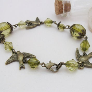 Green vintage bronze bracelet with bird charms and beads