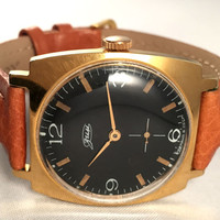 """Vintage men's wristwatch called """"ZIM""""-Pobeda, mechanical Soviet watch,lovely black dial and gold numerals. New leather band included."""