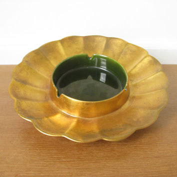 Freeman-McFarlin gold leaf pottery ashtray with green glazed center, signed Anthony