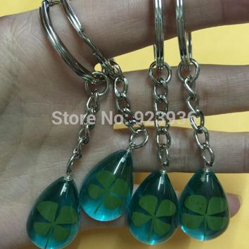Free Shipping 12 pcs Hot sale real shamrock fine green four leaf clover blue occult drop keychain