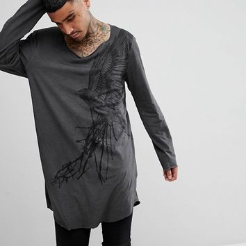 ASOS DESIGN super longline long sleeve t-shirt with eagle print and heavy wash at asos.com