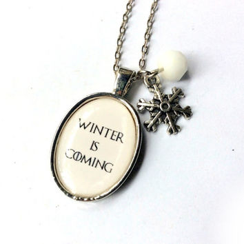 Winter is Coming necklace: resin cabochon pendant, snowflake charm, and snow white crystal bead