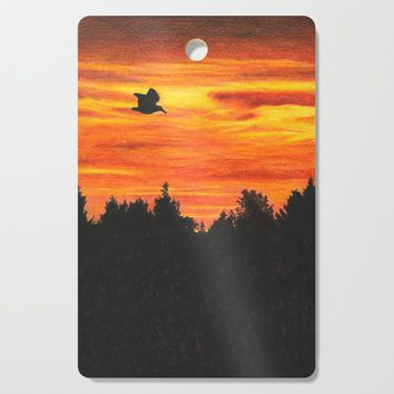 Sunset sky with bird Cutting Board by savousepate