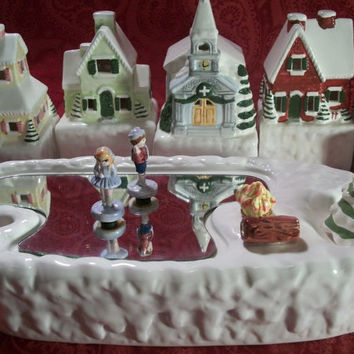 Delightful 8 Piece Ice Skating Village Music Box Lighted Christmas WInter Wonderland Holiday Decor from TKSPRINGTHINGS Christmas  Collection
