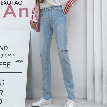 EXOTAO Ripped Jeans Woman High Waist Destroyed Blue Solid Denim Trousers For Ladies Irregular Holes Casual Zipper Slim Jeans Fem