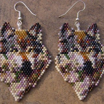 Hand Made Seed Beaded Brick Stitch Wolf Of Many Colors by wolflady