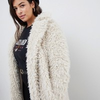 Vero Moda Curve Oversized Teddy Coat at asos.com