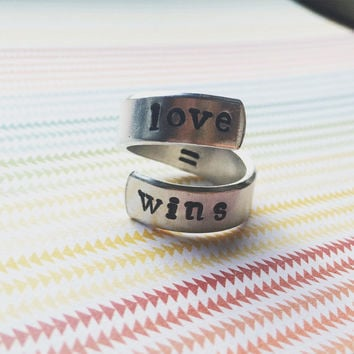 love wins  spiral hand stamped aluminium ring