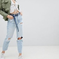 Bershka light washed ripped jean in blue at asos.com