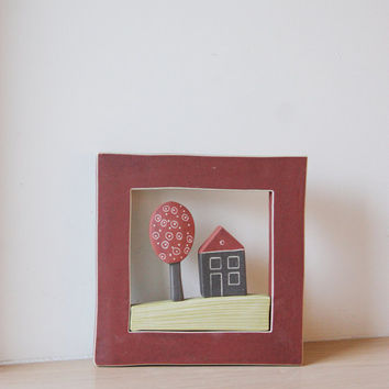 Ceramic Greek cottage with tree, stoneware wall hanging of a house and tree in a square, red  frame