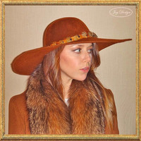 A Millinery Couture Floppy Brim 100 Percent Wool Felt Sienna Women's Hat with a Vintage Hat band Made of Pheasant Ring Neck Feathers