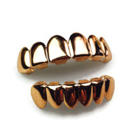 The 'Roses of War' Rose Gold Grills Set by Refinement Co.