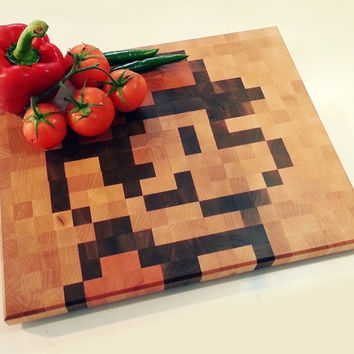 End-grain hardwood chopping board with retro pixel art design - MARIO