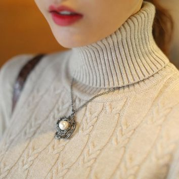 Long sleeve, turtle-neck sweater