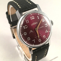 "Vintage Soviet men's ""ZIM - POBEDA CARNAVIN"" wristwatch, with deep, dark red dial .Comes with brand new leather band!"