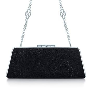 Tiffany & Co. -  Sabrina clutch in shimmer onyx leather. More colors available.