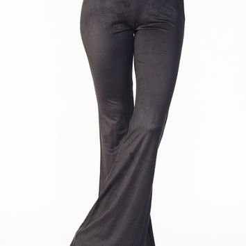 Get your fall trend look with these faux suede Bell Bottom. These slip on style flare bell bottom feature stretch faux suede material, elastic waist band, wide leg fit, and finished with stitching detail. Pair with 70's button up top and clog shoes. Unline