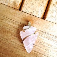 Rose quartz arrowhead tension set in hand forged polished sterling silver pendant