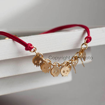 Gold Skull Bracelet, Tiny Skeleton Bracelet, Skull Charm Bracelet on Red Leather Cord