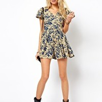 ASOS PETITE Exclusive Playsuit in Vintage Floral Print at asos.com