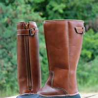 Our The Autumn Boot are perfect for this season! They're a rubber bottom boot with a tall shaft. Zipper located on the back with buckle overlay. The are lined