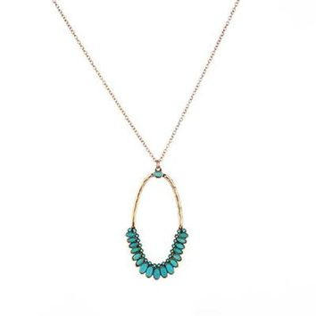 Natural raw stone necklace featured on a metal chain.