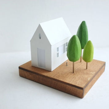Glowing house with small portico window - miniature lighted architecture - geometric nightlight structure