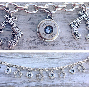 Bullet jewelry. Charm bracelet with pistols and bullet casings