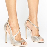Carvela Geep Metallic Asymetric Strap Heeled Sandals at asos.com