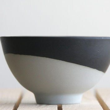 Ceramic bowl in concrete gray with black mat glaze.Great for serving soups and desserts. Urban and modern look.
