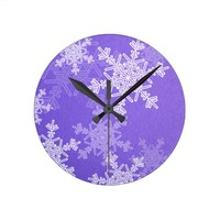 Girly deep blue and white Christmas snowflakes Round Clocks