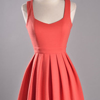 Flirty orange heart shaped back out dress