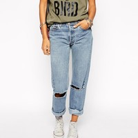 Milk It | Milk It Vintage High Waisted Mom Jeans With Ripped Knees And Roll Hem at ASOS