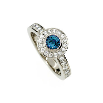 London blue topaz halo engagement ring made from white gold, diamond, bezel, solitaire, unique, teal engagement, topaz solitaire, blue halo