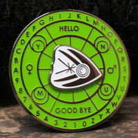 "Spirit Board Spinner ""Glow in the Dark"" enamel pin from Never Not Clever"