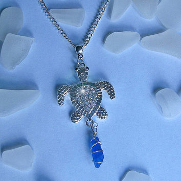Sea glass necklace with crystal sea turtle and blue sea glass. Beach glass jewelry.