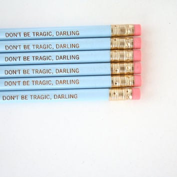 don't be tragic, darling. 6 engraved pencils baby blue.