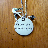 """Hunger Games Inspired Necklace. Katniss """"I am the mockingjay"""". Hand stamped, silver colored, charm pendant, Swarovski crystal, jewelry."""