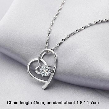Lovely silver heart shaped white rhinestone pendant necklace