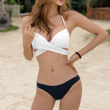 Hot sale new halter bikini upper white and bottom black chest straps cross knot two piece swimsuit